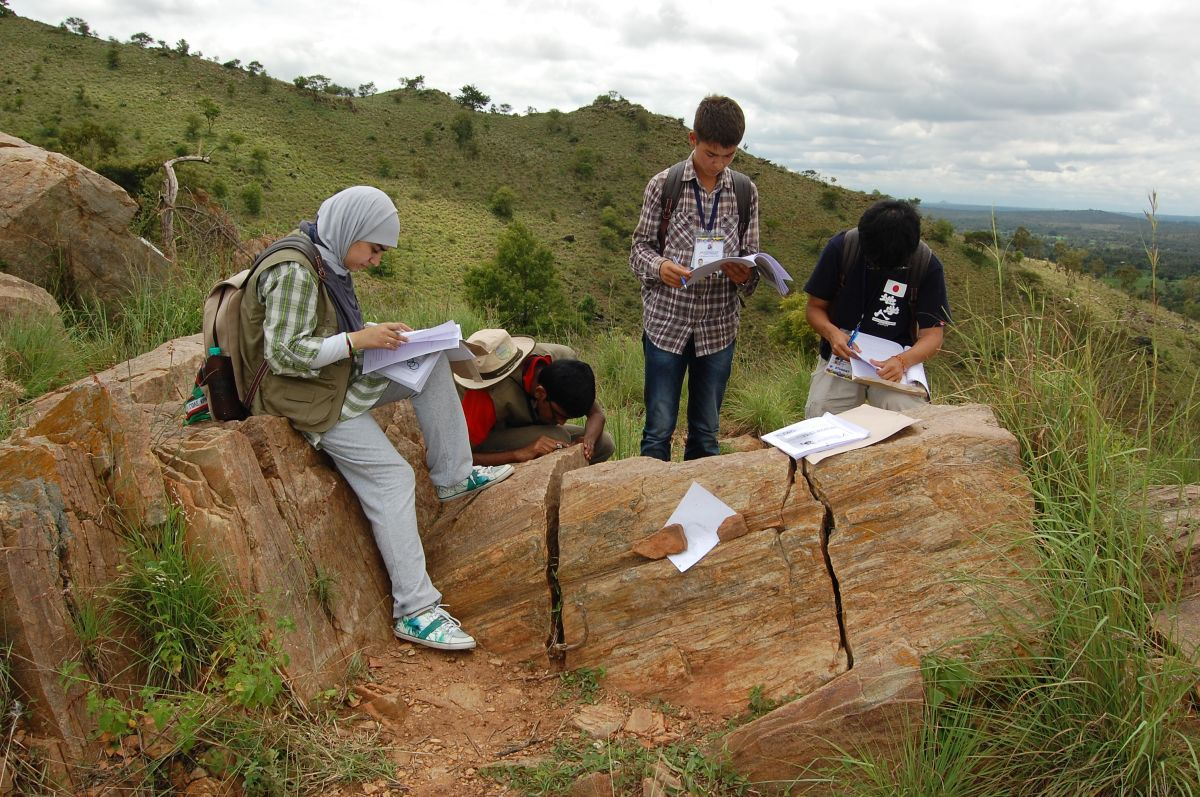 """Examination of rock in field"""